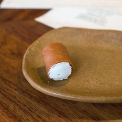 Quince paste cigar with whipped goats milk cheese
