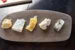 Assortment of cheeses, bread, jams